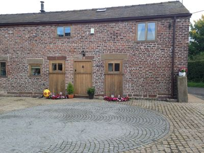Photo for The Old Mill Cottage 2 bedroomed 250 yr old cottage hot tub swimming pool