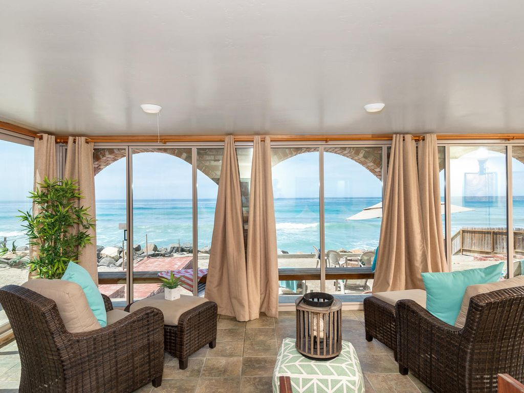 gorgeous single family beach home designer vrbo lounge area with a beach view
