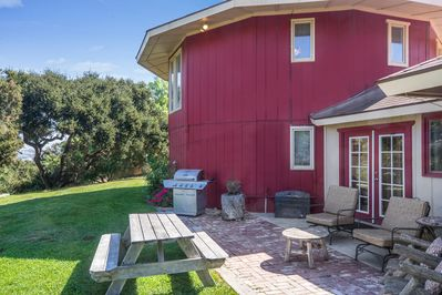 Exterior  - Rolling backyard with picnic table, ample seating, and gas grill.