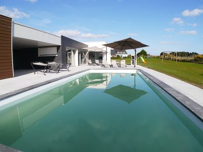 Photo for Close to the beach, modern house with large pool and sea views