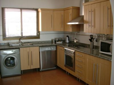 Large exceptionally well  equipped modern kitchen has all mod cons.