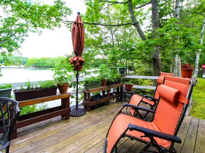 Photo for Charming cabin with gorgeous waterfront views, a deck & porch swing!