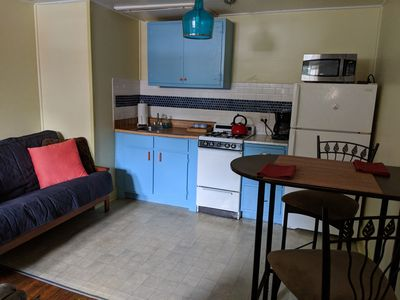 Full urban kitchen: gas range, oven, microwave and full size refrigerator.