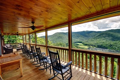 Enjoy the HUGE screened in rocker porch!