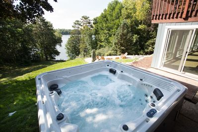 Enjoy a relaxing time in the hot tub while having a great view of the lake!