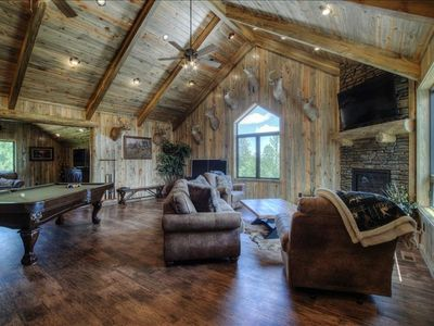 5 bed/5/12 bath all on suite lodge.  Located minutes from Deadwood.  Loft entertainment area.