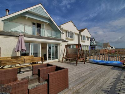 Photo for Situated directly on Pevensey Bay beach and enjoying superb sea views