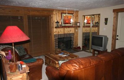 Living room with fireplace and Smart TV/DVD,  seats 8 + access to deck and grill