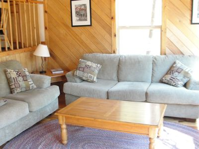 Comfortable seating in the living room, with a view of the valley below.