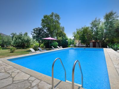 Photo for Great apartment with large pool, 2 bedrooms, kitchen, bathroom, air conditioning, barbecue and large garden