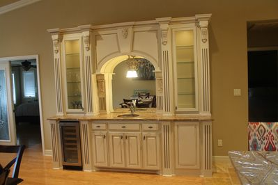 Wet bar with wine cooler.