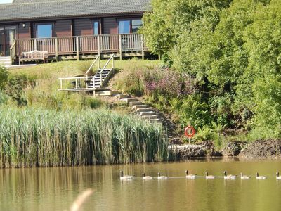 Photo for Waterside Lodge with private gardens & fishing in Hartland Forest Parc with Wifi