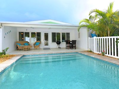 Visit  Anna Maria Island! Relax at Heliconia House, enjoy your own heated pool!