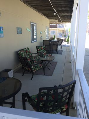 Photo for ENJOY YOUR FAVORITE BEVERAGE FEELING THE OCEAN BREEZE ON THE LARGE PORCH