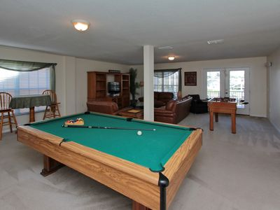 Full Size Pool Table And A Small Foosball Table Provided In Your Own Game  Room.