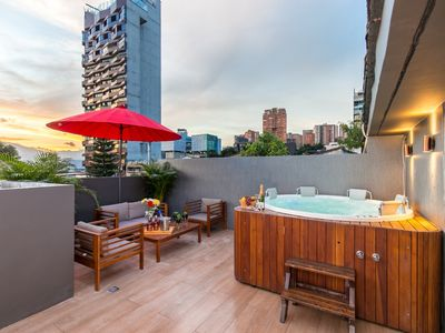 Photo for Two Bedroom Balcony Hot tub on balcony 1 block Lleras front desk