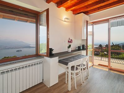 Photo for Cozy cottage, surrounded by nature with a unique view of Lake Maggiore