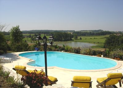 Heated  Pool overlooking lake and gorgeous landscape