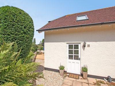 Photo for Delightful, detached apartment, with distant sea views.