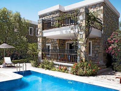 Photo for Ortakent 2 Bedroom Villa Janan. 2 floors, garden with pool, 1salo of + 2 rooms including 4 people, is a building made of stone, built in traditional style