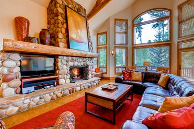 Great room - with large windows (in the wintertime enjoy excellent views of the ski resort), Gas Fireplace and TV