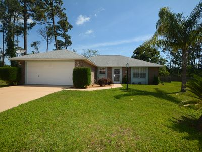 Photo for Charming Pool Home only minutes away from the beach