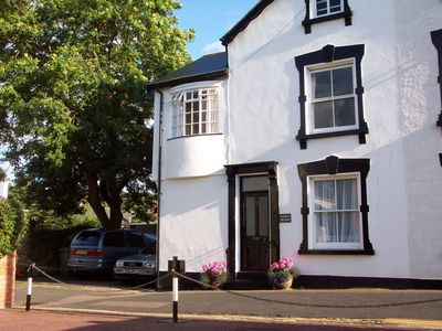 Photo for Delightful Victorian Cottage tucked away in Regency Sidmouth, Devon