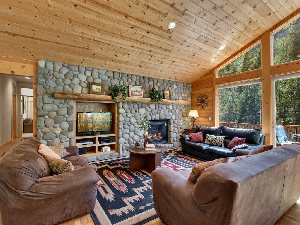 River Rock Fireplace Flat Screen TV And Lots Of Seating For Gatherings