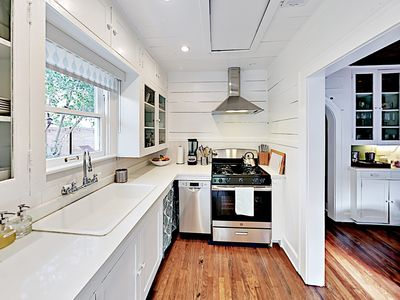 Kitchen - Beautifully remodeled, your bungalow features a stylish interior with hardwood floors and ample natural light.
