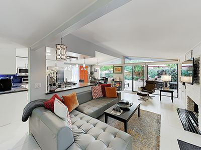 Living Area - Clean lines and leather seating in the living room. Complimentary Wi-Fi provided.