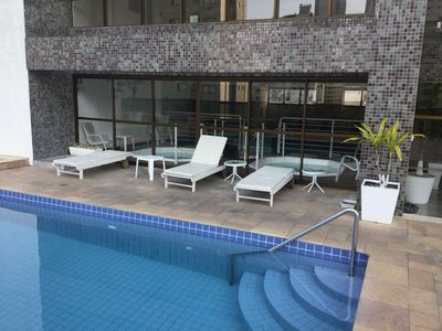 Photo for BEAUTIFUL APT WITH SWIMMING POOLS, WI-FI, AIR. COND., NEAR THE SEA, GARAGE.
