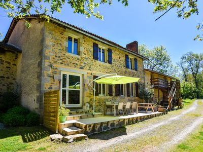 Photo for Beautiful renovated mill with large garden, terrace and heated swimming pool.