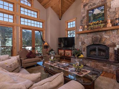 Great Room has soaring ceiling, fireplace and big windows for the beautiful view
