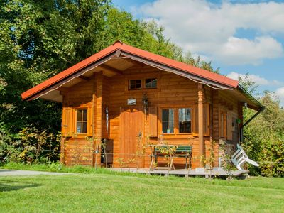 Photo for Cozy log cabin on a nice campsite