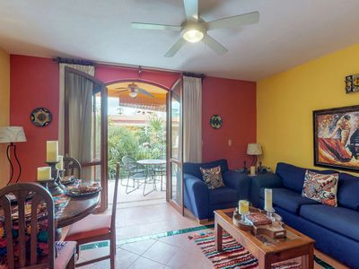 Photo for NEW LISTING! Colorful condo with shared pool and gym, great location