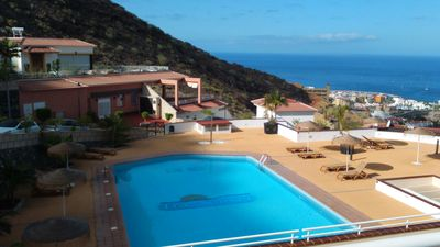 Photo for Nice apartment with sea views and large heated pool. FREE WIFI