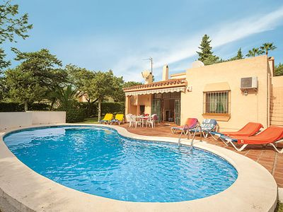 Photo for Family-friendly villa w/ gated pool, lawns + BBQ, walking distance from beach