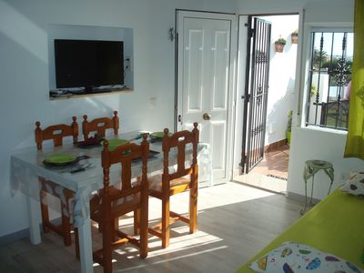 Photo for impressive apartment in ground floor with terrace of two rooms, A / C and pool
