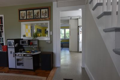 View into living room and kitchen from front door.
