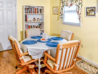 A comfortable table for meals, there is another on the enclosed porch.