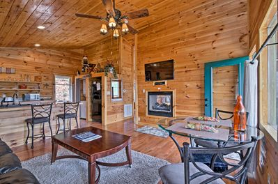 The log cabin living space features modern comforts for 2 guests.