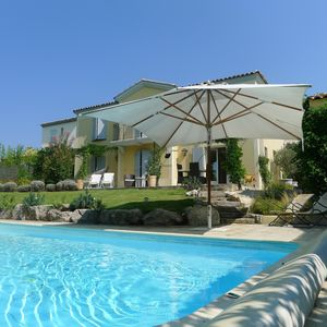 Photo for A stunning villa with private pool, pool house, BBQ and landscaped gardens.