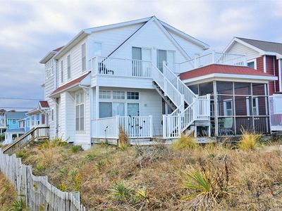 Photo for FREE ACTIVITIES!! Sitting directly on the ocean front nestled in the heart of down town this lovely 7 bedroom, 5 bath vacation home is the perfect central location to walk or bike ride anywhere in Bethany Beach!