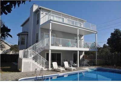 Tri-level home with patio and two balconies