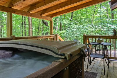 Private covered back deck with hot tub