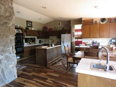 kitchen and dining area--view is from floor-to-ceilings windows over lake.