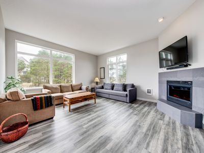 Photo for Polished beach house w/ ocean views, private grill, free WiFi - steps to beach!
