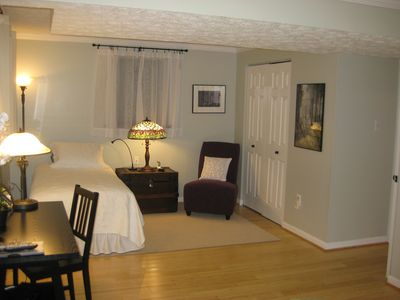 Twin bed on opposite side of the room. Double closet holds ironing board & iron