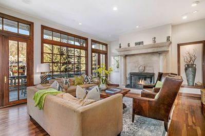 Comfortable living space to gather with friends and family by the wood burning fireplace.