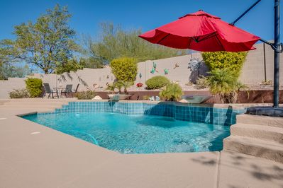 Sparkling pool with water features.